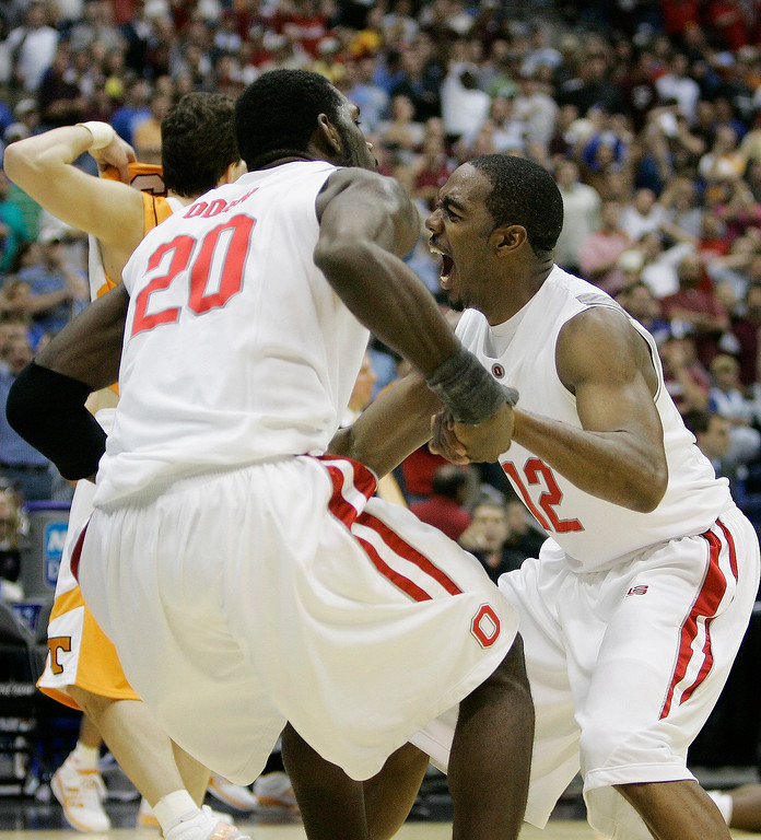 . Ohio State\'s Greg Oden (20) and Ron Lewis (12) react at the end of an 85-84 win over Tennessee in their NCAA South Regional semifinal basketball game at the Alamodome in San Antonio, Thursday, March 22, 2007.  (AP Photo/Eric Gay)
