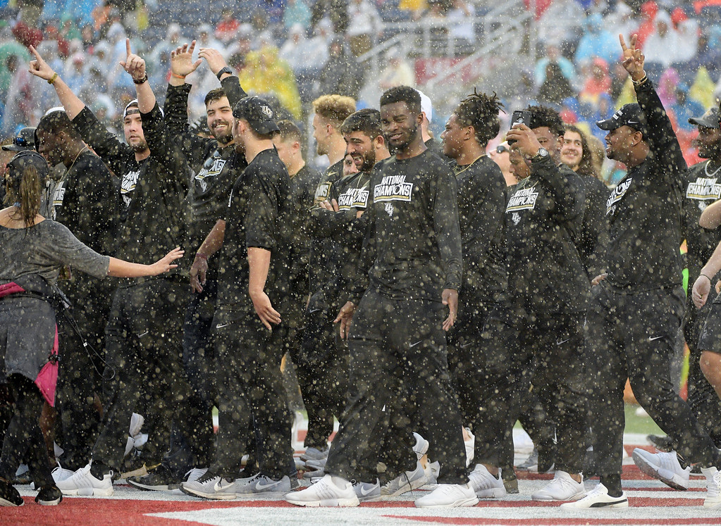 . The University of Central Florida football team is cheered on the field, during the first half of the NFL Pro Bowl football game between the National Football Conference and the American Football Conference, Sunday, Jan. 28, 2018, in Orlando, Fla. (AP Photo/Phelan M Ebenhack)
