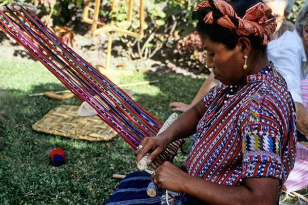 I love their textiles.  Her blouse is so beautiful, vivid colors, great textures.  The warp on the loom is as colorful as the fabric she'll produce.