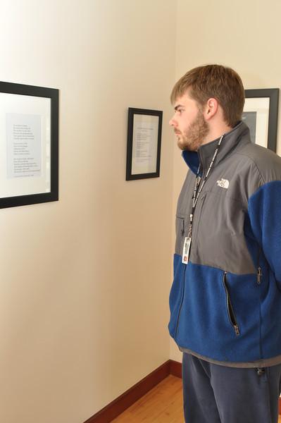 Gardner-Webb Student, Andrew Slesinger observes the work of Joseph Gascho.