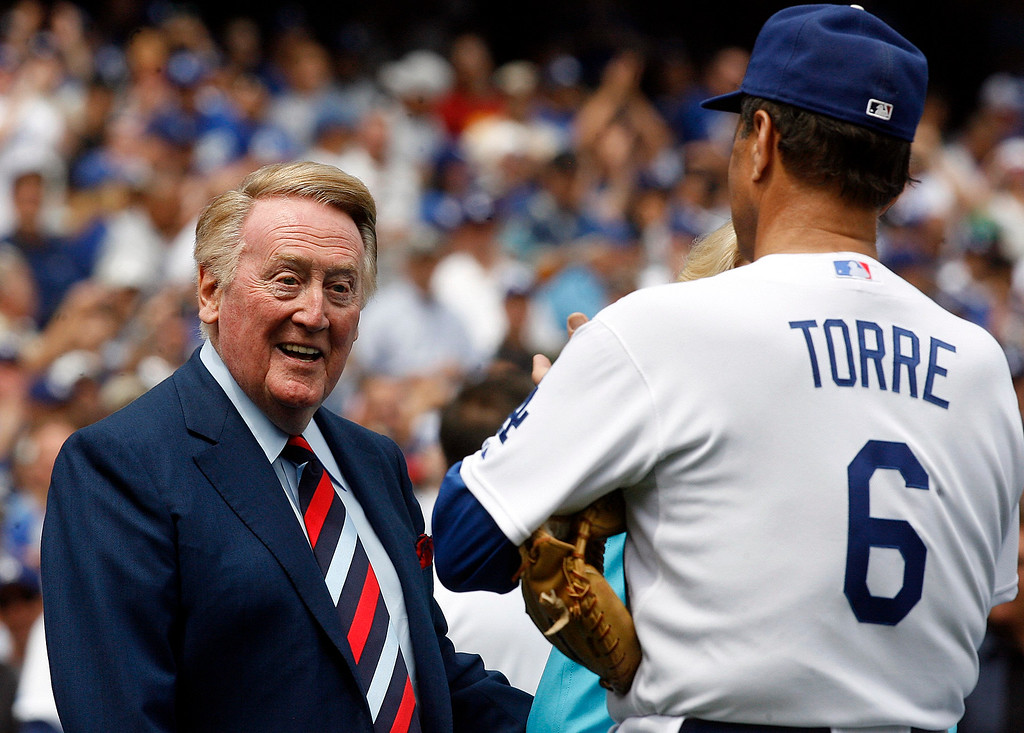 . Vin Scully smiles at Joe Torre before the home opener between the San Francisco Giants and the Los Angeles Dodgers at Dodger Stadium on Monday April 13, 2009 in Los Angeles. (SGVN/Staff Photo by Keith Birmingham/SPORTS)
