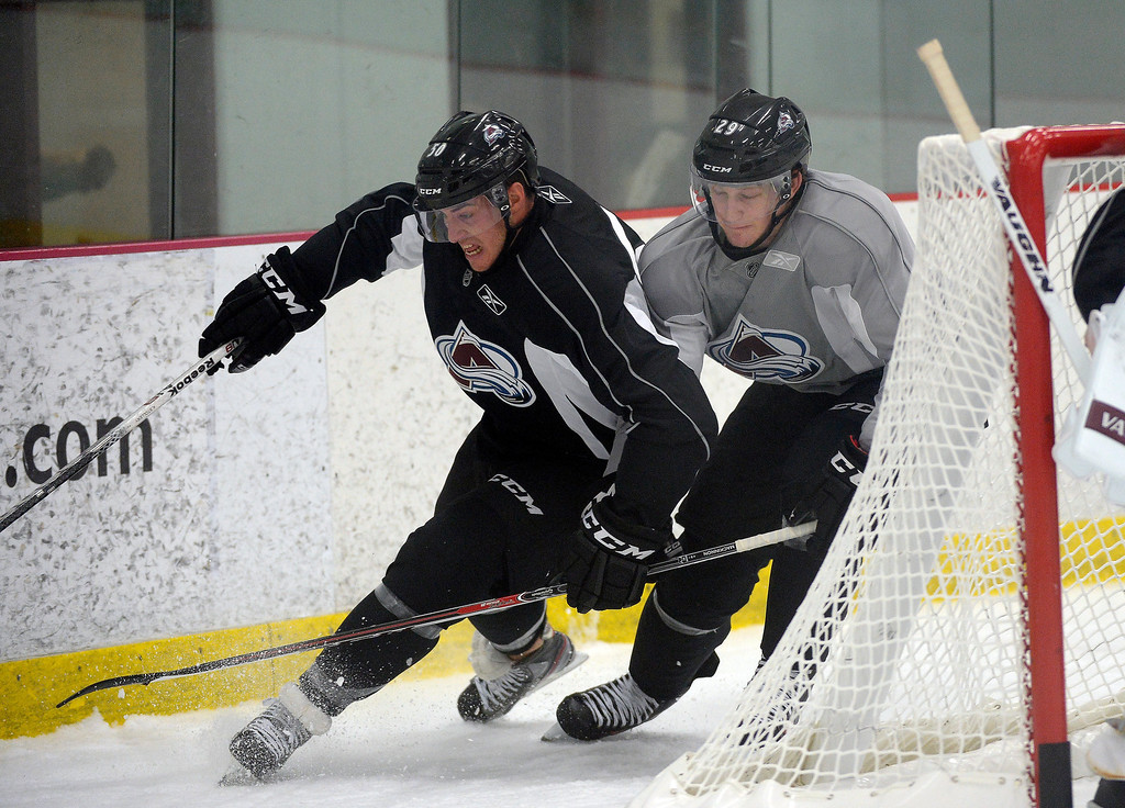 . Colorado Avalanche Nathan MacKinnon (29) battles with Lee Moffie (50) for the puck on the first day of Avalanche rookie camp September 8, 2013 at Family Sports. (Photo by John Leyba/The Denver Post)
