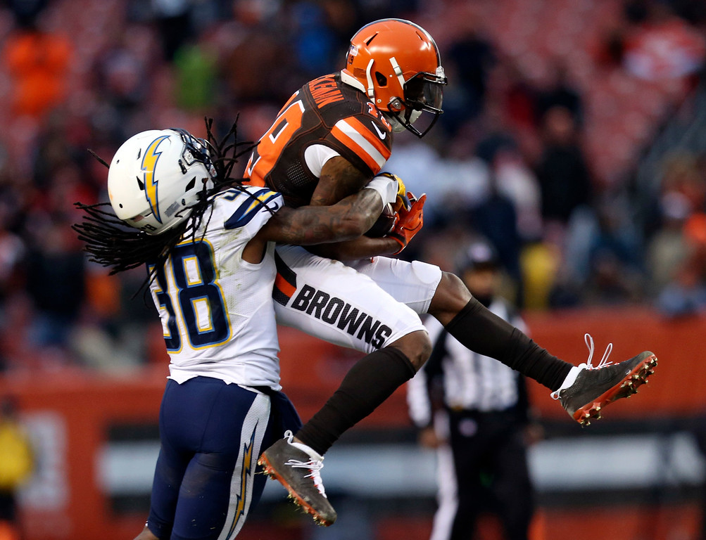 . Cleveland Browns wide receiver Corey Coleman (19) makes a catch for a first down against San Diego Chargers cornerback Trovon Reed (38) in the second half of an NFL football game, Saturday, Dec. 24, 2016, in Cleveland. (AP Photo/Aaron Josefczyk)