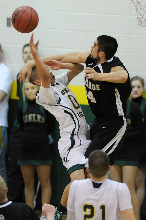 . Arapahoe post Matt Glasscock (44) fouled Mountain Vista guard Damani Respass (0) as he went to the hoop in the second half. The Mountain Vista High School boy\'s basketball team defeated Arapahoe 69-54 Friday night January 4, 2013.  Karl Gehring/The Denver Post