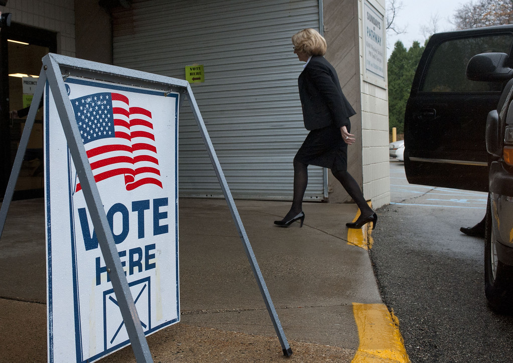 . State Senate candidate Terri Lynn Land arrives to vote on Election Day at Pathway Church in Byron Center, Mich. Tuesday, Nov. 4, 2014. (AP Photo/The Grand Rapids Press, Chris Clark )