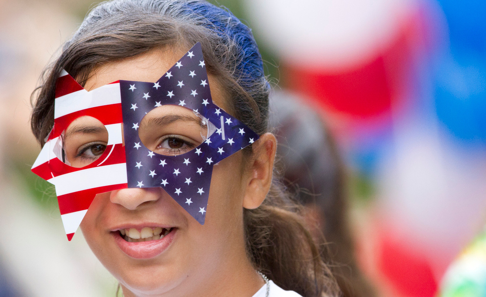 Description of . Alyssa Garza participates in the Oak Ridge Fourth of July parade Friday, July 4, 2014 in Oak Ridge, Texas. (AP Photo/ The Courier, Jason Fochtman)