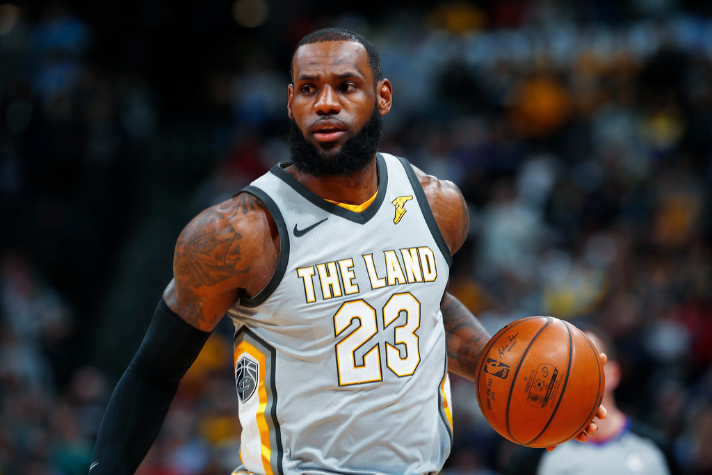 . Cleveland Cavaliers forward LeBron James brings the ball up the court against the Denver Nuggets in the first half of an NBA basketball game Wednesday, March 7, 2018, in Denver. (AP Photo/David Zalubowski)