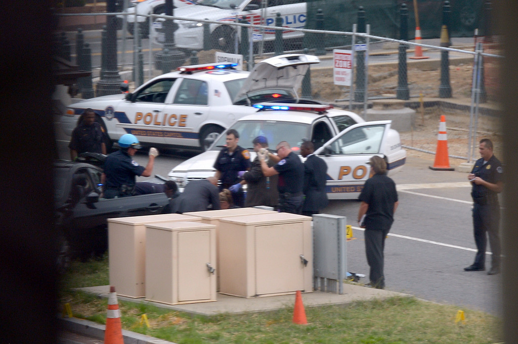 """. Capitol Hill police are seen at the site of a shooting October 3, 2013 on Capitol Hill in Washington, DC. The US Capitol was placed on security lockdown Thursday after shots were fired outside the complex, senators said. \""""Shots fired outside the Capitol. We are in temporary lock down,\"""" Senator Claire McCaskill said on Twitter. Police were seen running within the Capitol building and outside as vehicles swarmed to the scene. AFP PHOTO / Mandel  NGAN/AFP/Getty Images"""