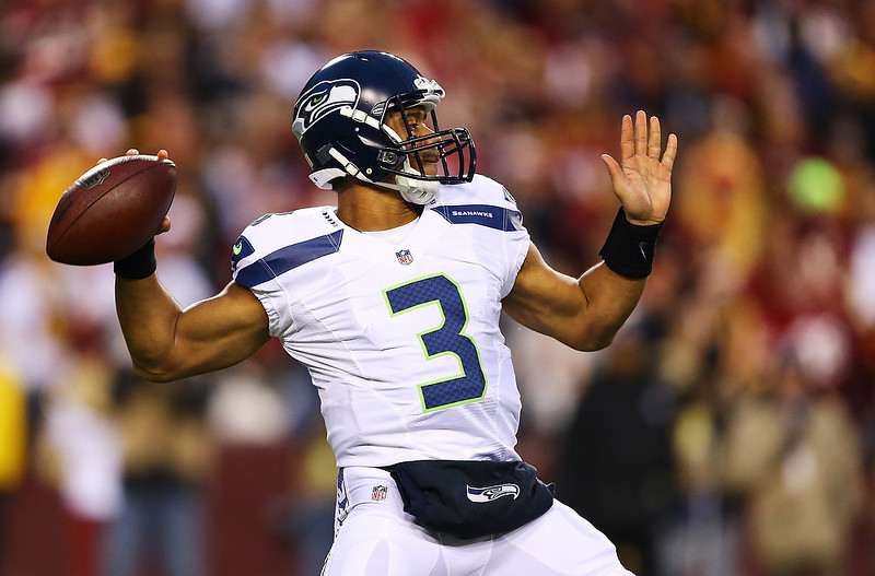 . Russell Wilson #3 of the Seattle Seahawks looks to pass against the Washington Redskins during the NFC Wild Card Playoff Game at FedExField on January 6, 2013 in Landover, Maryland.  (Photo by Al Bello/Getty Images)
