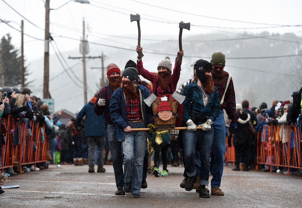 . Mayra Walter is carried through downtown Nederland by her coffin team on Saturday during 2018 Frozen Dead Guy Days in Nederland. The festival continues on Sunday. For more photos, go to dailycamera.com. Cliff Grassmick  Photographer  March 10, 2018