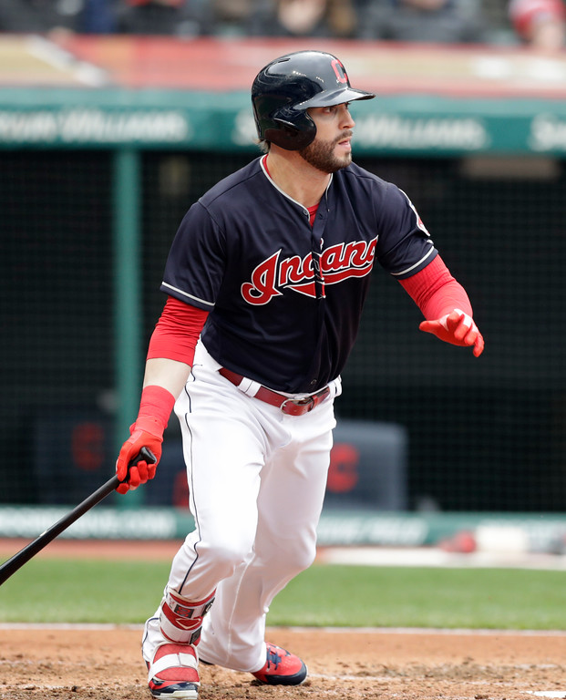 . Cleveland Indians\' Tyler Naquin watches his ball after hitting an RBI-single off Seattle Mariners starting pitcher Mike Leake in the second inning of a baseball game, Saturday, April 28, 2018, in Cleveland. Edwin Encarnacion scored on the play. (AP Photo/Tony Dejak)
