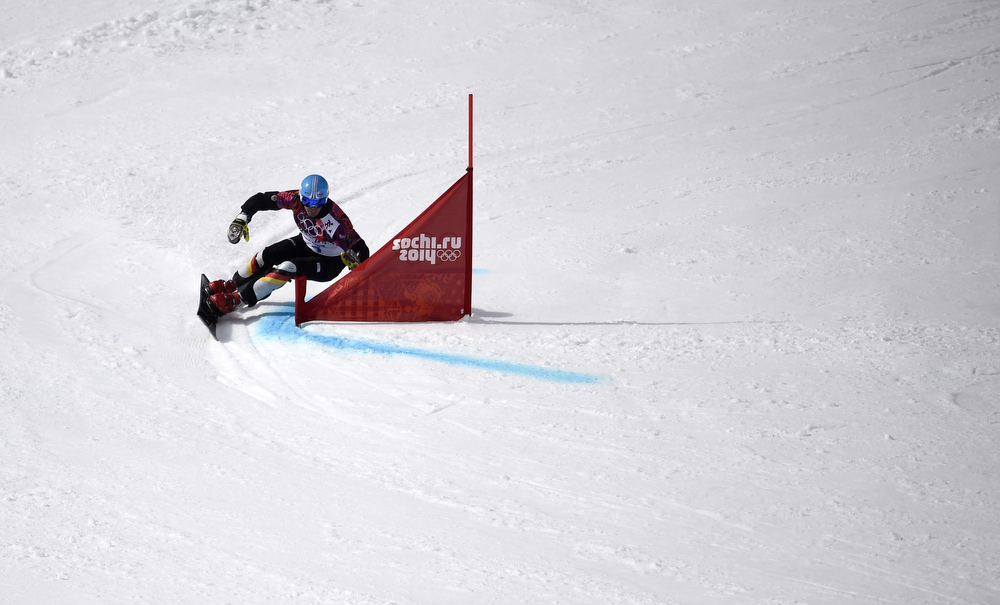 . Germany\'s Patrick Bussler competes in the Men\'s Snowboard Parallel Giant Slalom 1/8 Finals at the Rosa Khutor Extreme Park during the Sochi Winter Olympics on February 19, 2014. FRANCK FIFE/AFP/Getty Images