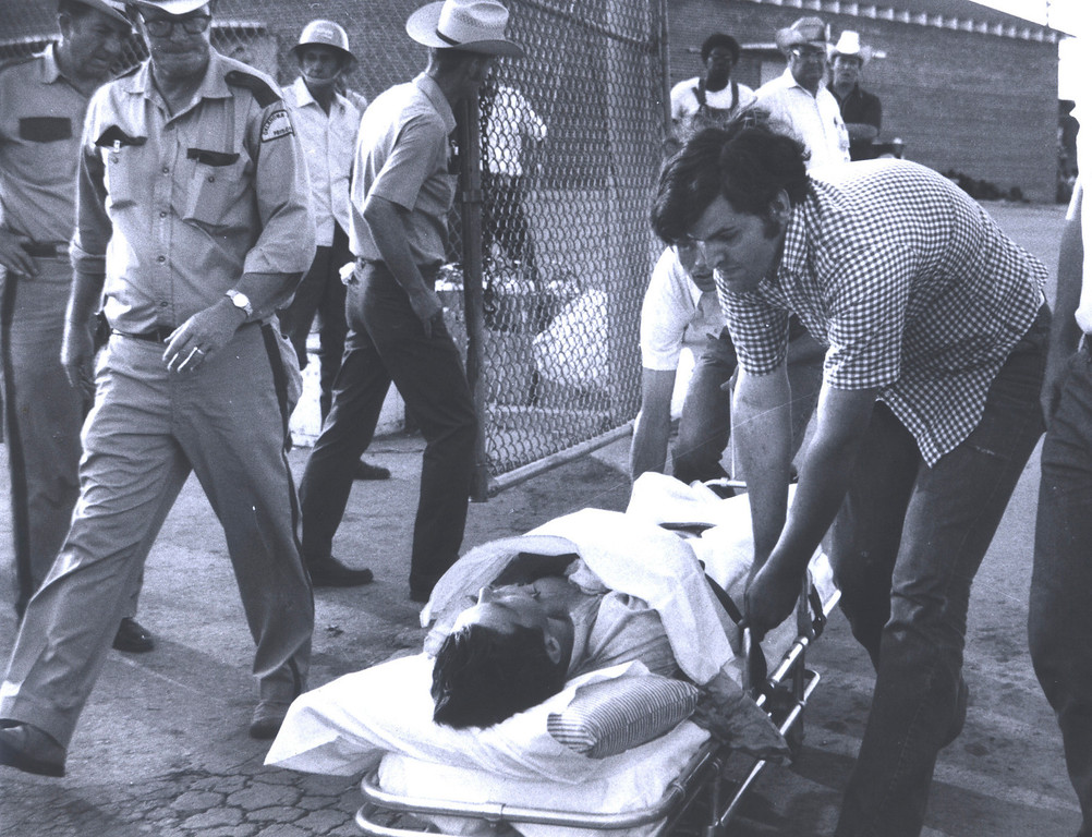 . In this July 1973 photo provided by the Oklahoma Department of Corrections, an unidentified inmate is taken out on a stretcher from the Oklahoma State Penitentiary at McAlester in McAlester, Okla. during one of the most destructive prison riots in American history. (AP Photo/Oklahoma Department of Corrections)