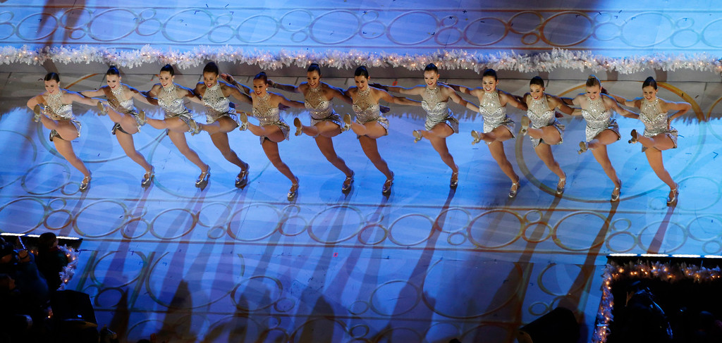 . The Rockettes dance on stage before the lighting of the Rockefeller Center Christmas tree, Wednesday, Dec. 4, 2013, in New York. (AP Photo/Kathy Willens)