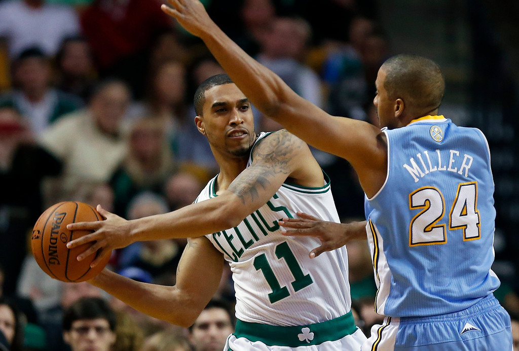 . Boston Celtics\' Courtney Lee (11) keeps the ball away from Denver Nuggets\' Andre Miller (24) in the second quarter of an NBA basketball game in Boston, Friday, Dec. 6, 2013. (AP Photo/Michael Dwyer)