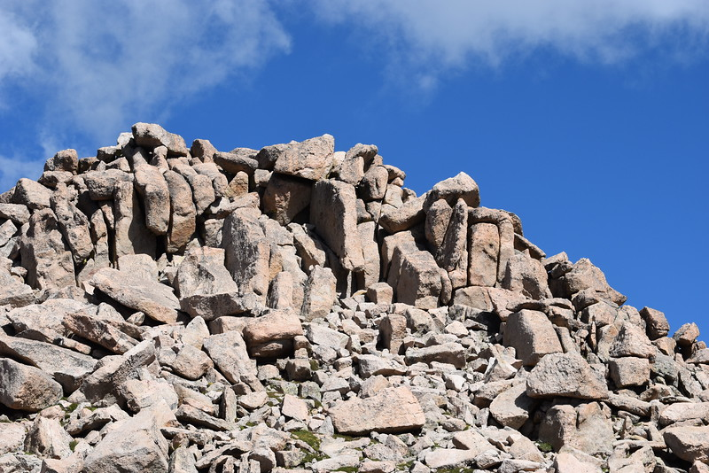 The highest point, as viewed from the summit parking lot. Hike a few hundred yards to summit a 14'er.