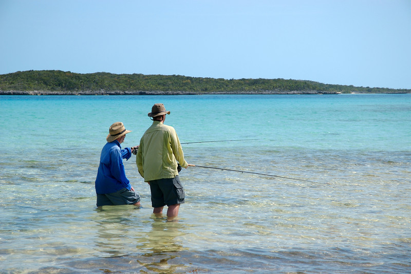 A fly fisherman pointing out Bonefish to his freind in the Exuma Islands, bahamas