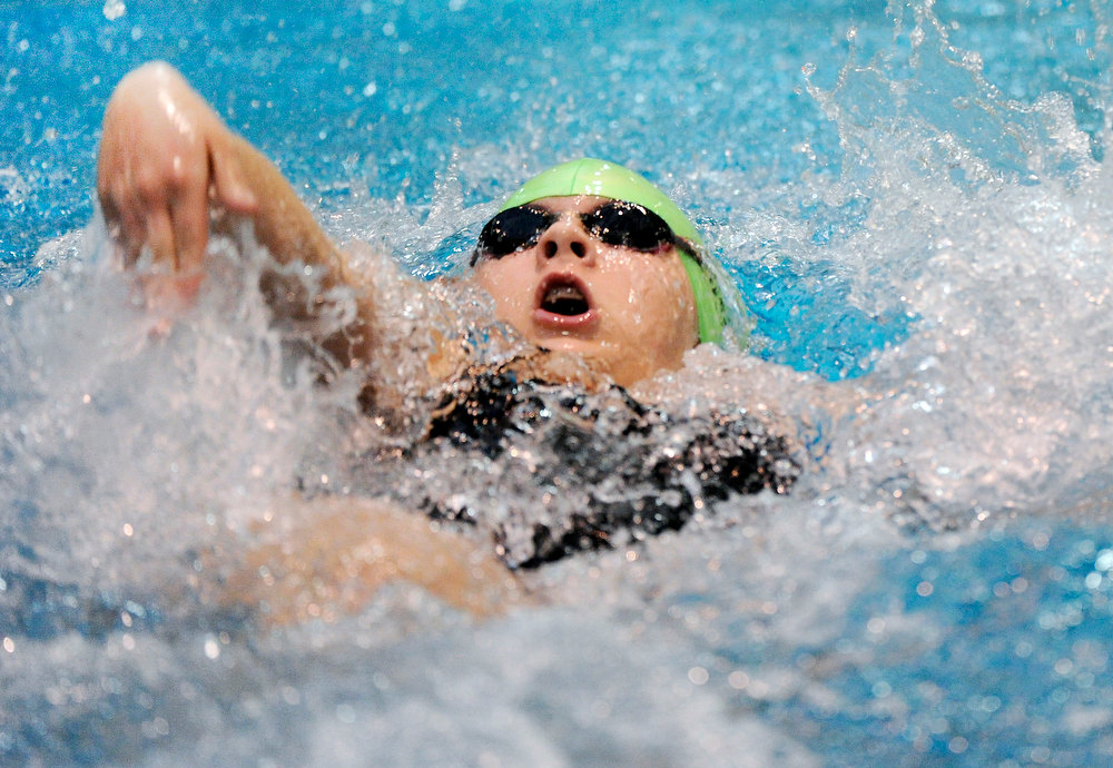 . Fossil Ridge High School\'s Emilee Dinkel swam the backstroke to begin the team\'s 200-Yard Medley Relay race Saturday night. The Colorado Coaches Invitational Swimming and Diving Meet wrapped up Saturday night, December 15, 2012.  Karl Gehring/The Denver Post