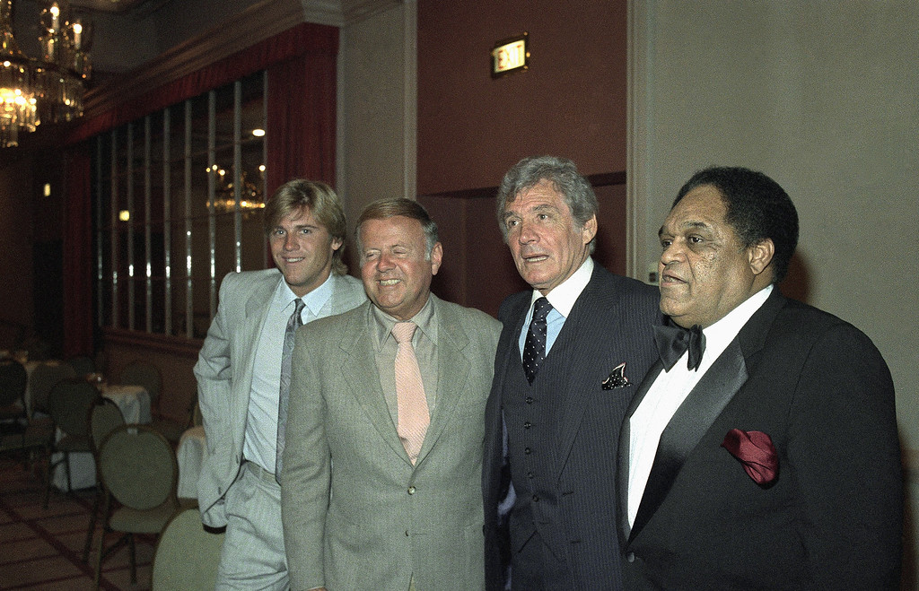 . Vincent Van Patten, Dick Van Patten, Gene Barry and Slappy White appear at roast for Milton Berle, April 14, 1986. (AP Photo)