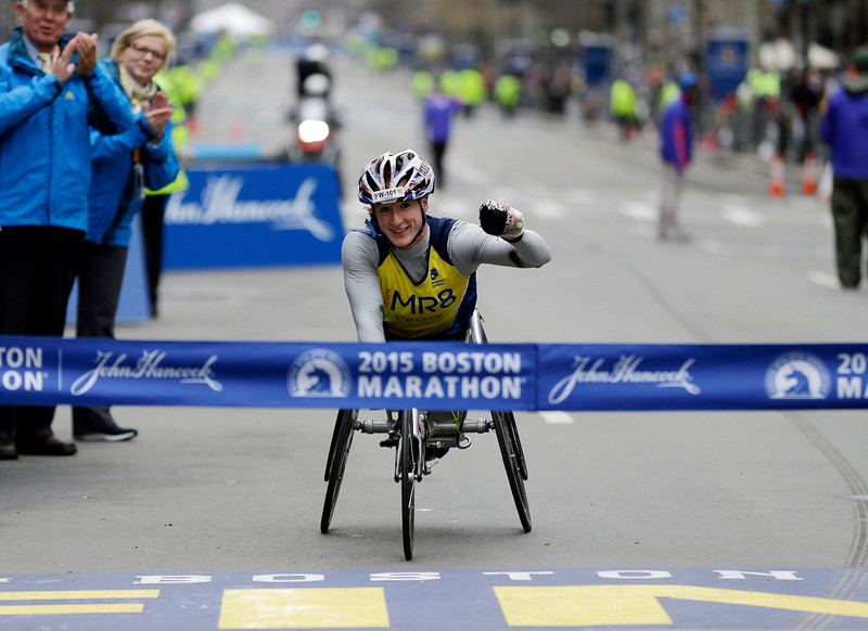 . Tatyana McFadden, of Russia, crosses the finish line to win the women\'s wheelchair division of the Boston Marathon, Monday, April 20, 2015, in Boston. (AP Photo/Elise Amendola)
