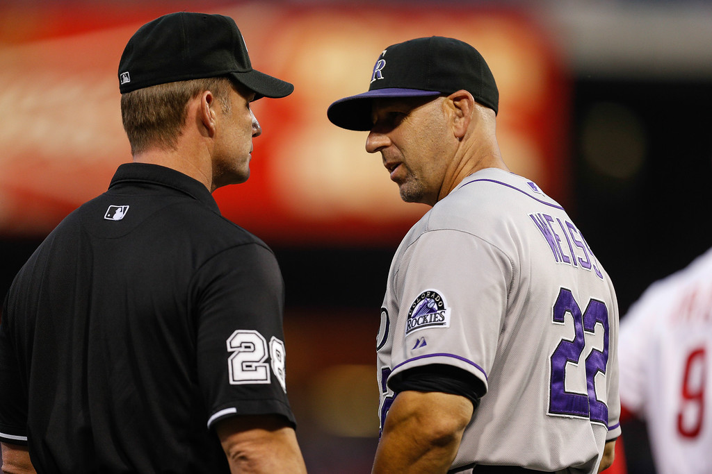 . PHILADELPHIA, PA - AUGUST 22: Walt Weiss #22 of the Colorado Rockies speaks to umpire Jim Wolf #28 after a play in the second inning of the game against the Philadelphia Phillies at Citizens Bank Park on August 22, 2013 in Philadelphia, Pennsylvania. (Photo by Brian Garfinkel/Getty Images)