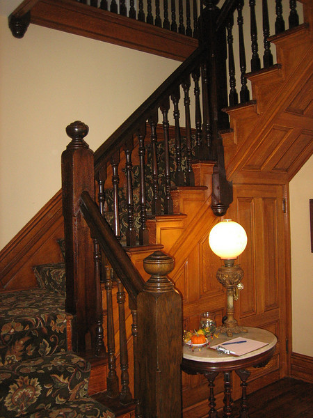 The ballisters, newel posts and handrails were in disrepair and were reconstructed with computer-matched parts.  The finish is Minwax dark walnut and four coats of hand-rubbed orange shellac.  The wood panels replicate quarter-sawn oak with a faux finish called country graining.  This was achieved using a mix of burnt umber and apple cider vinegar over two coats of an oil-based paint applied with blue-steel graining combs and graining rollers.  This was the inspired work of artist Dan Mulligan, Chester, NJ.