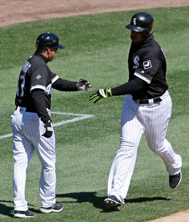 . Chicago White Sox\'s Jose Abreu, right, cerebrates with third base coach Joe McEwing after hitting a solo home run during the third inning of a baseball game against the Cleveland Indians, Saturday, April 9, 2016, in Chicago. (AP Photo/Nam Y. Huh)