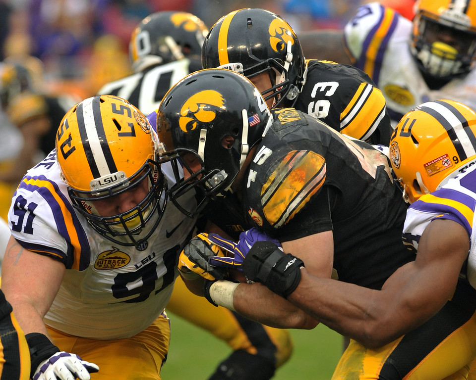 . Running back Mark Weisman #45 of the Iowa Hawkeyes runs for a gain against Christian LaCouture #91 of the LSU Tigers January 1, 2014 in the Outback Bowl at Raymond James Stadium in Tampa, Florida.  (Photo by Al Messerschmidt/Getty Images)