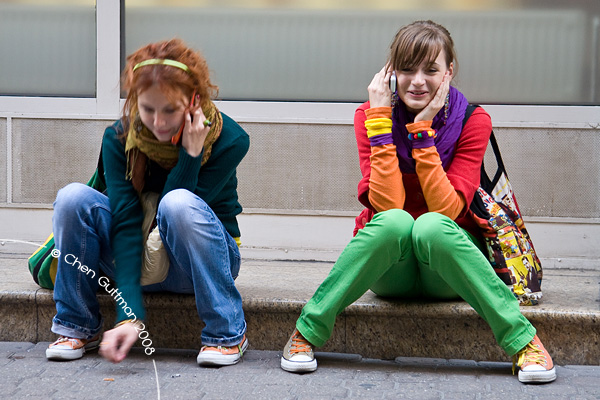 Colorful girl deeply chatting on their cellphone, Vaci Utca.