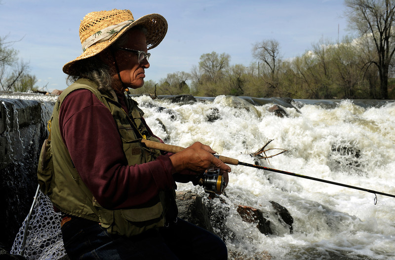 . Urban fishing on Monday, May 13, 2013 along the South Platte River in Denver with Ronnie Crawford at the falls by Overland Pond Park.   (Photo By Cyrus McCrimmon/The Denver Post)