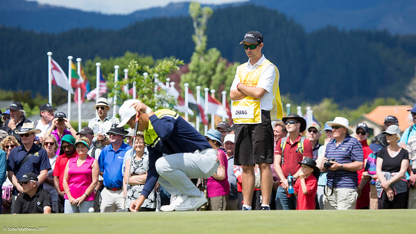 Andy Zhang from China with his caddy Ben Slaven on the 18th green on the final day of the Asia-Pacific Amateur Championship tournament 2017 held at Royal Wellington Golf Club, in Heretaunga, Upper Hutt, New Zealand from 26 - 29 October 2017. Copyright John Mathews 2017.   www.megasportmedia.co.nz