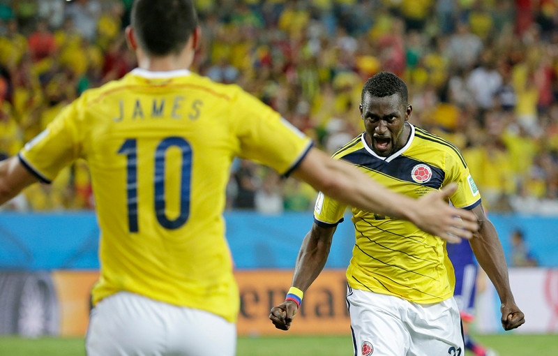 . Colombia\'s Jackson Martinez, right, celebrates with teammate Colombia\'s James Rodriguez after scoring his teams third goal during the group C World Cup soccer match between Japan and Colombia at the Arena Pantanal in Cuiaba, Brazil, Tuesday, June 24, 2014. (AP Photo/Felipe Dana)