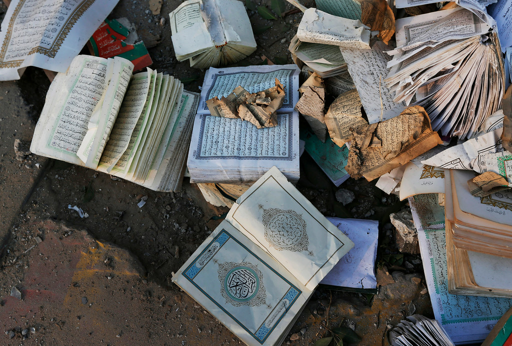. Copies of the Quran, Islam\'s holy book, some damaged, are pictured after they were salvaged from inside the Al Aqsa Martyrs mosque in Gaza City, destroyed by an overnight Israeli strike, on Tuesday, July 22, 2014. Diplomatic efforts intensified to end the two week war that has killed more hundreds of Palestinians and dozens of Israelis. (AP Photo/Lefteris Pitarakis)