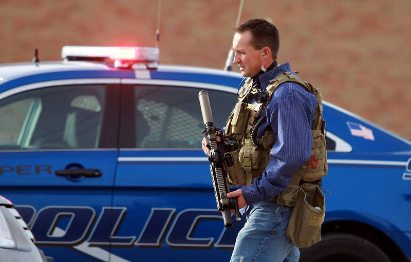 . A Natrona County Sheriff\'s deputy in tactical gear leaves the scene of a reported homicide at Casper College on Friday morning, Nov. 30, 2012, in Casper, Wyo. At least one person was killed and another was wounded Friday in an attack at Casper College, a community college in central Wyoming. It happened around 9 a.m., said school spokesman Rich Fujita.  (AP Photo/Casper Star-Tribune, Alan Rogers)
