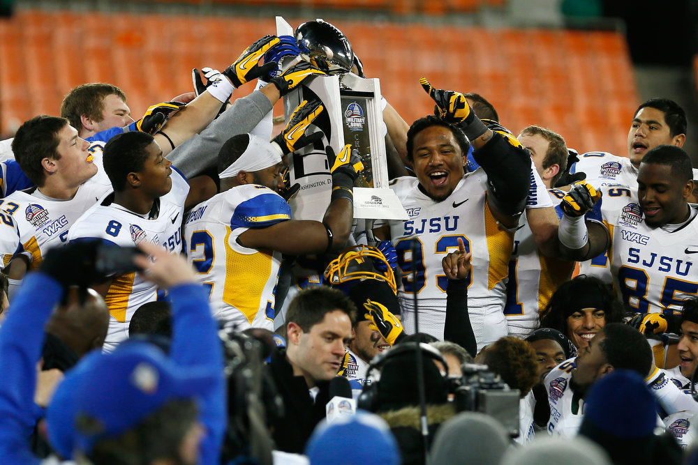 Description of . WASHINGTON, DC - DECEMBER 27: Members of the San Jose State Spartans hold up the trophy after defeating the Bowling Green Falcons 29-20 to win the Military Bowl at RFK Stadium on December 27, 2012 in Washington, DC.  (Photo by Rob Carr/Getty Images)