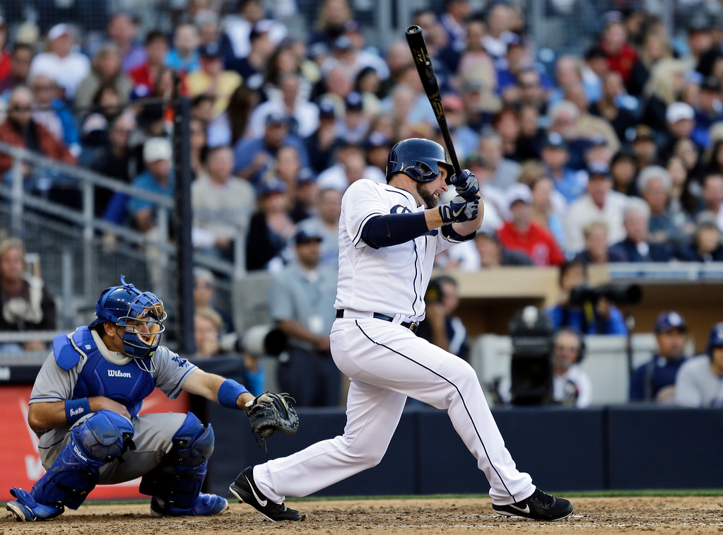 . San Diego Padres\' Mark Kotsay watches his RBI double against the Los Angeles Dodgers in the seventh inning of a baseball game in San Diego, Tuesday, April 9, 2013. (AP Photo/Lenny Ignelzi)