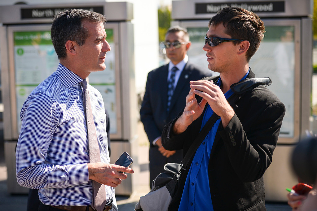 . Los Angeles mayor Eric Garcetti visits with Tyler Brawley of Los Angeles at the North Hollywood Metro station on Monday, March  17, 2014.   ( Photo by David Crane/Los Angeles Daily News )