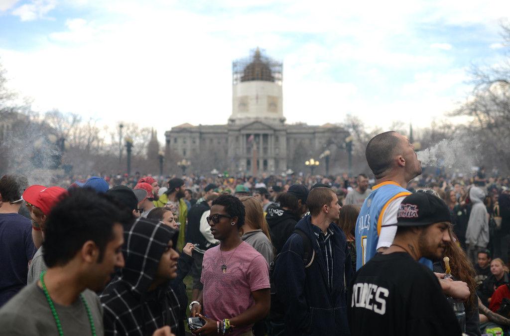 . DENVER, CO. - APRIL 20 : A crowd of marijuana smokers celebrate the counterculture holiday known as 4/20 on the first celebration since Colorado and Washington made pot legal for recreation use. (Photo By Hyoung Chang/The Denver Post)