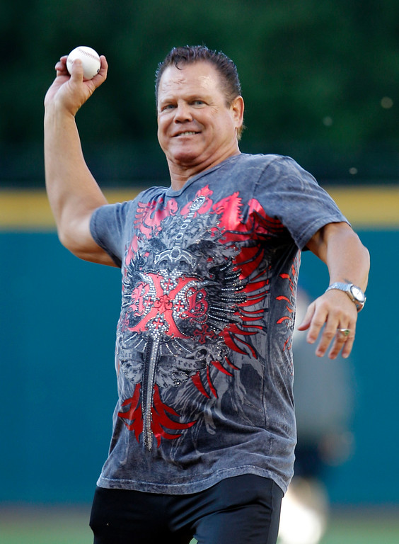 ". WWE wrestling star Jerry ""The King\"" Lawler throws out the ceremonial first pitch before a baseball game between the Cleveland Indians and the Texas Rangers, Thursday, June 2, 2011, in Cleveland.   (AP Photo/Amy Sancetta)"