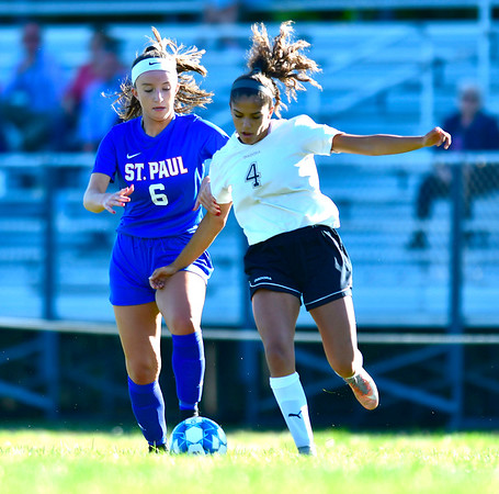 9/17/2019 Mike Orazzi | StaffrSt. Paul's Delaney Jordan (6) and Woodland's Erica Poehailos (4) during girls soccerr in Bristol Tuesday afternoon.