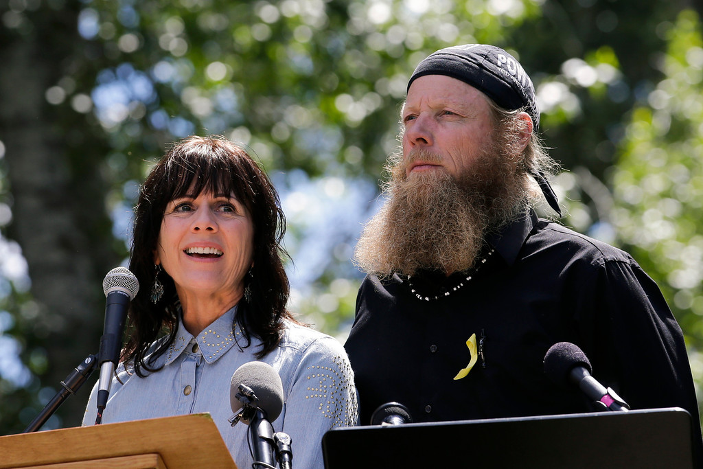 """. Jani Bergdahl, left, joined by husband, Bob, the parents of captive U.S. Army Sgt. Bowe Bergdahl, speaks at the \""""Bring Bowe Back\"""" celebration held to honor Sgt. Bergdahl in Hailey, Idaho, Saturday, June 22, 2013. Hundreds of activists for missing service members gathered in a small Idaho town Saturday to hear the parents of the only known U.S. prisoner of war speak just days after his Taliban captors announced they want to exchange him for prisoners being held at Guantanamo Bay. (AP Photo/Jae C. Hong)"""
