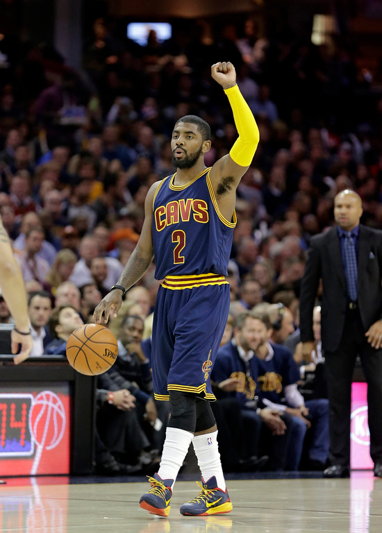 . Cleveland Cavaliers\' Kyrie Irving moves the ball downcourt during an NBA basketball game against the New York Knicks Thursday, Oct. 30, 2014, in Cleveland. (AP Photo/Tony Dejak)