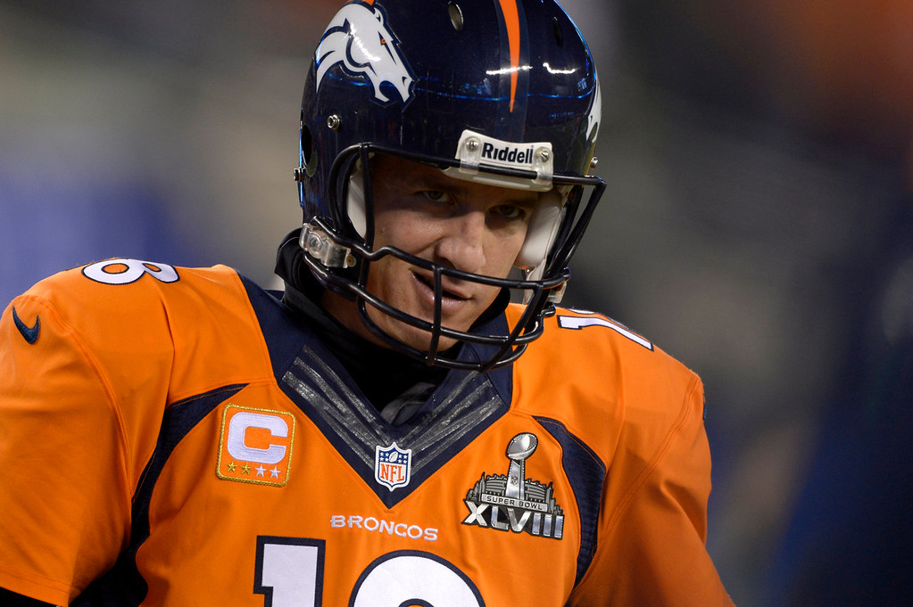 . Denver Broncos quarterback Peyton Manning (18) warms up before the game. The Denver Broncos vs the Seattle Seahawks in Super Bowl XLVIII at MetLife Stadium in East Rutherford, New Jersey Sunday, February 2, 2014. (Photo by John Leyba/The Denver Post)