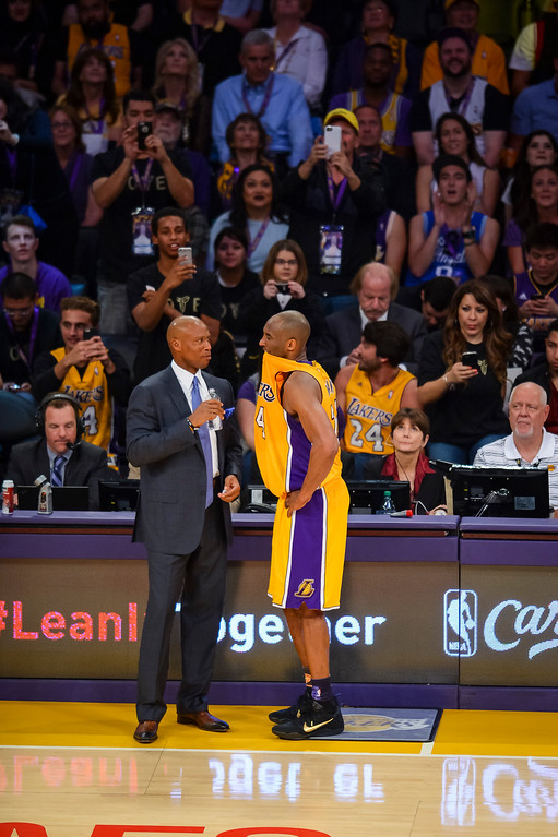 . Kobe Bryant talks to coach Bryon Scott during first half action against the against the Utah Jazz. April 13, 2016. Los Angeles, CA. (Photo by David Crane/Southern California News Group)