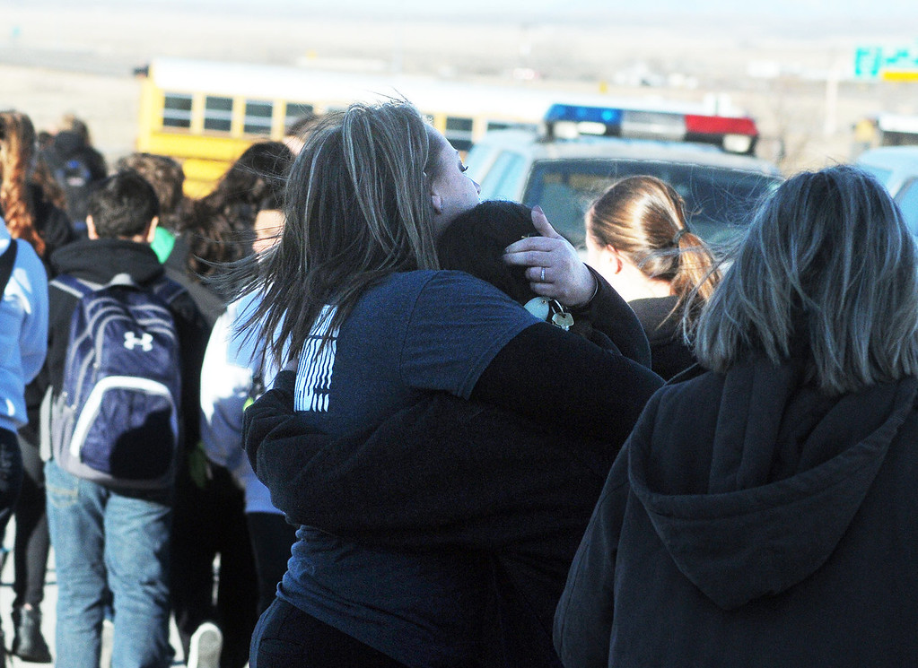 . Students are escorted from Berrendo Middle School following a shooting, Tuesday, Jan. 14, 2014, in Roswell, N.M. Roswell police said the suspected shooter was arrested the school, but authorities have not said if there were any injuries. The school has been placed on lockdown. No other details are yet available. (AP Photo/Roswell Daily Record, Mark Wilson)