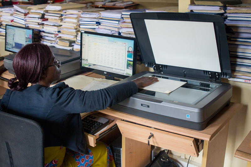 Monrovia, Liberia October 5, 2017  Workers at the National Archives scan documents.