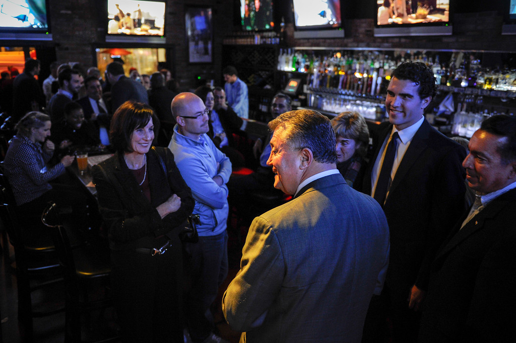 . Carmen Trutanich and his wife Noreen Trutanich, left, chat with supporters at the campaign party at Rocco\'s Tavern in Studio City, Tuesday, March 5, 2013. (Michael Owen Baker/Staff Photographer)