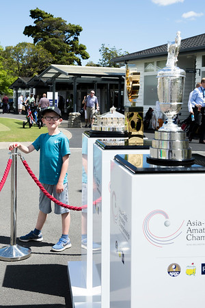 A young golf fan with the Masters Trophy, The Asia-Pacific Amateur Championship Trophy and the Claret Jug on the 3rd day of competition  in the Asia-Pacific Amateur Championship tournament 2017 held at Royal Wellington Golf Club, in Heretaunga, Upper Hutt, New Zealand from 26 - 29 October 2017. Copyright John Mathews 2017.   www.megasportmedia.co.nz