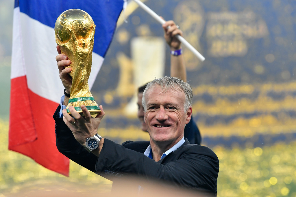 . France head coach Didier Deschamps lifts the trophy after France beat Croatia by 4-2 during the final match between France and Croatia at the 2018 soccer World Cup in the Luzhniki Stadium in Moscow, Russia, Sunday, July 15, 2018. (AP Photo/Martin Meissner)