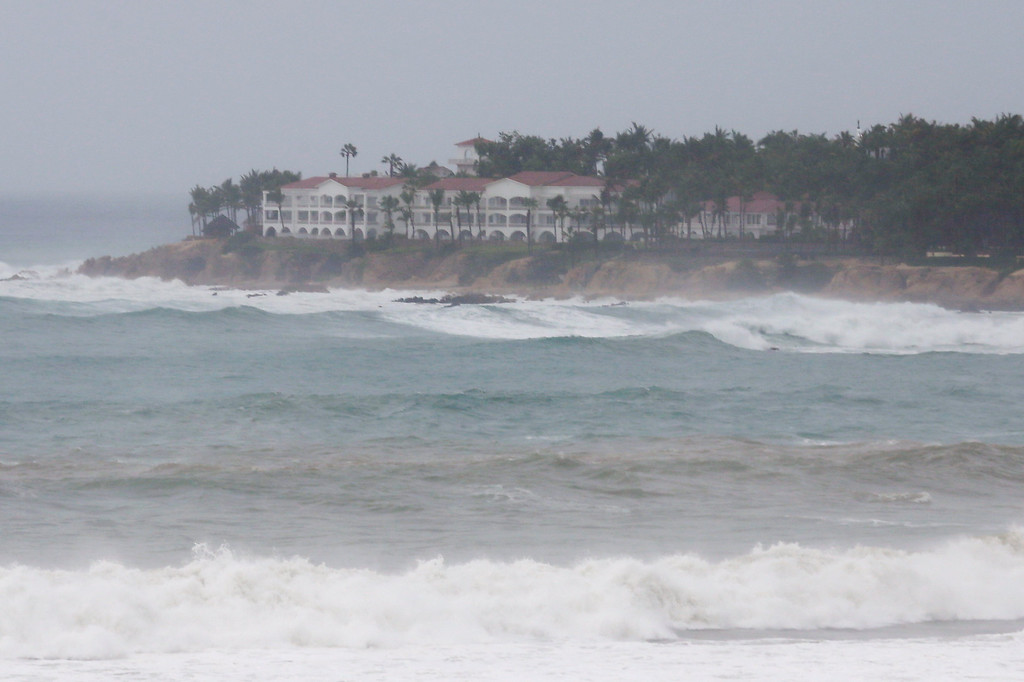 . Waves hit the coast of Los Cabos, Mexico, Sunday, Sept. 14, 2014. Hurricane Odile grew into a major storm Sunday and took aim at the resort area of Los Cabos, prompting Mexican authorities to evacuate vulnerable coastal areas and prepare shelters for up to 30,000 people. (AP Photo/Victor R. Caivano)